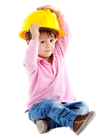 Beautiful kid on the floor playing with a helmet  - isolated over a white background