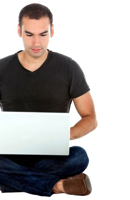 Man sitting on the floor with a laptop - isolated over a white background