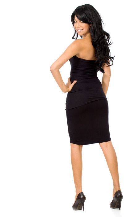 fashion girl standing in a black dress over a white background
