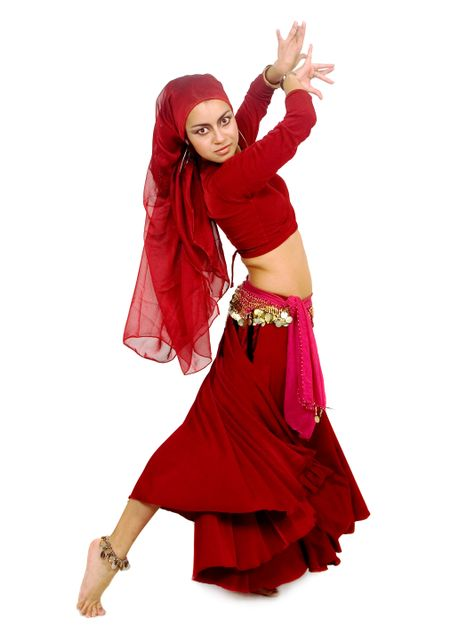 beautiful arabic belly dancer in red isolated over a white background