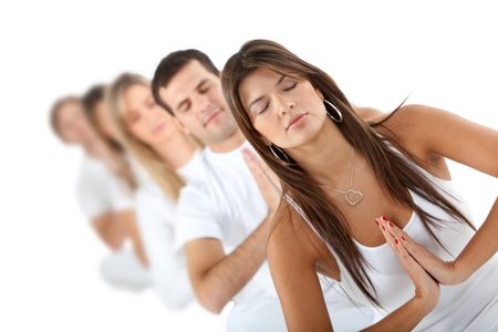 Group of people practicing yoga in white clothes ? isolated