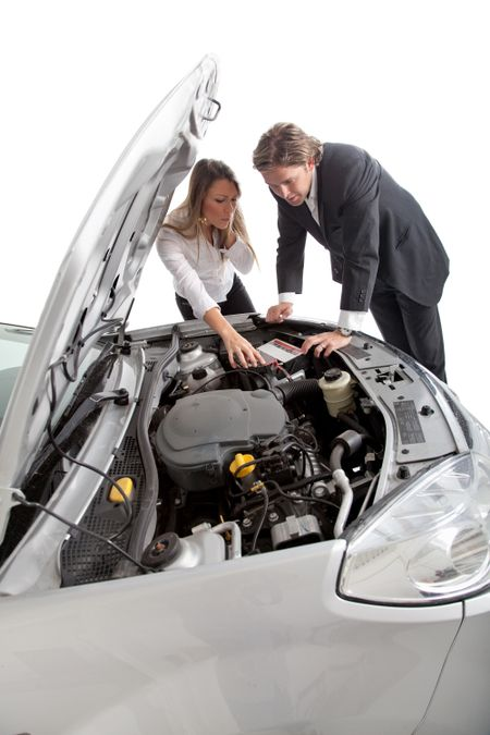 Couple having car trouble with an opened hood - isolated over a white