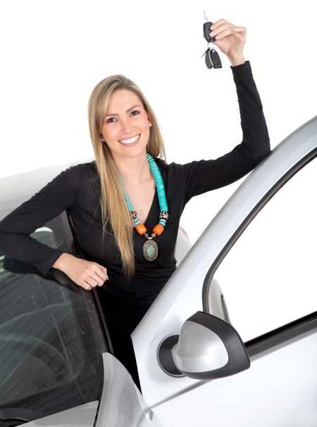 Happy woman with a car holding the keys ? isolated over a white background