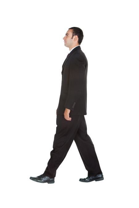 Elegant business man in a suit walking - isolated over a white background
