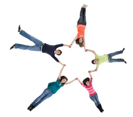 Group of friends lying on the floor making a circle - isolated over a white background