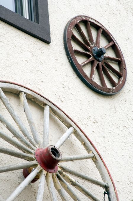 Wagon wheels above entrance to store