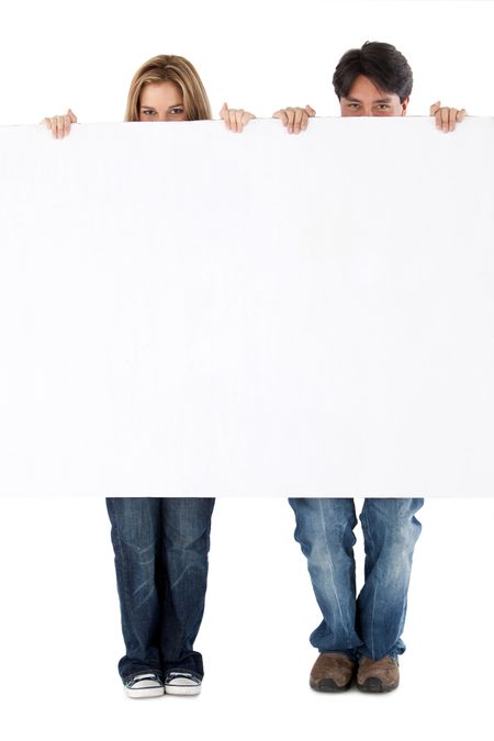 Beautiful couple displaying a banner ad isolated over a white background