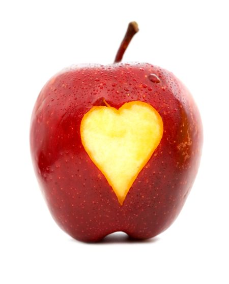 apple with a heart shape on it - isolated over a white background