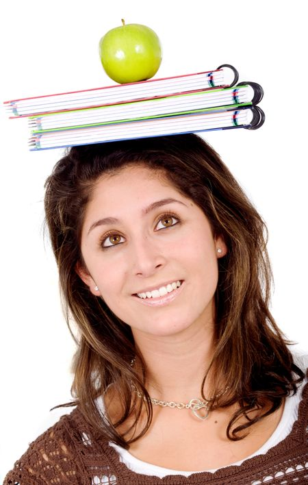 college student with notebooks and an apple on her head - isolated over a white background