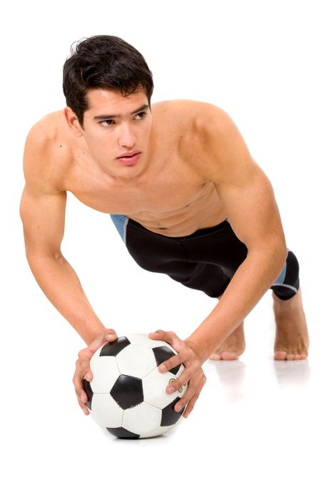 fashion male body leaning on a football ball isolated over a white background