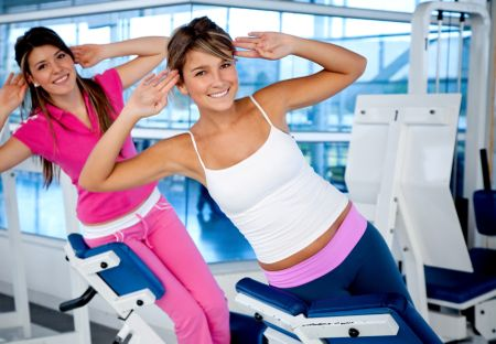 Beautiful women at the gym exercising on the machines