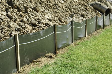 Temporary retaining wall of green plastic on construction site