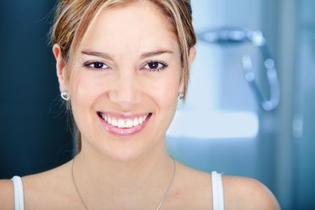Beauty portrait of a female smiling in a bathroom