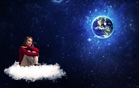 Caucasian woman sitting on a white fluffy cloud sitting and wondering at planet earth