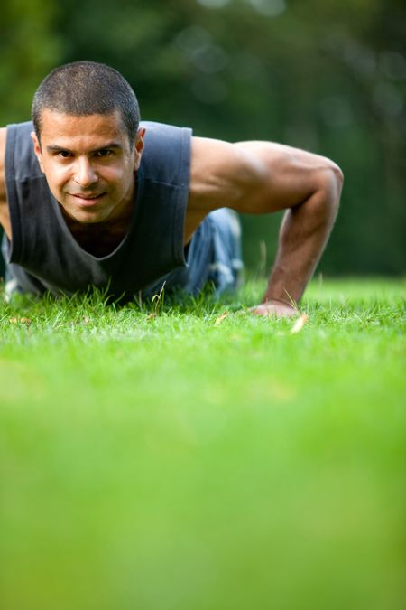 Handsome man exercising at the park - fitness concepts