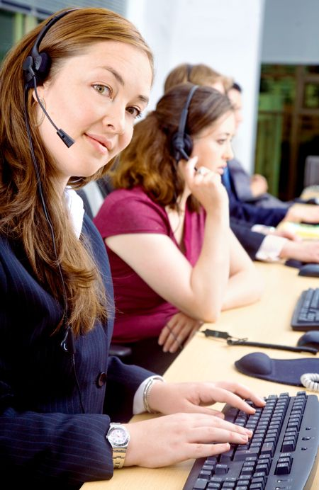 business team of customer service representatives on their computers