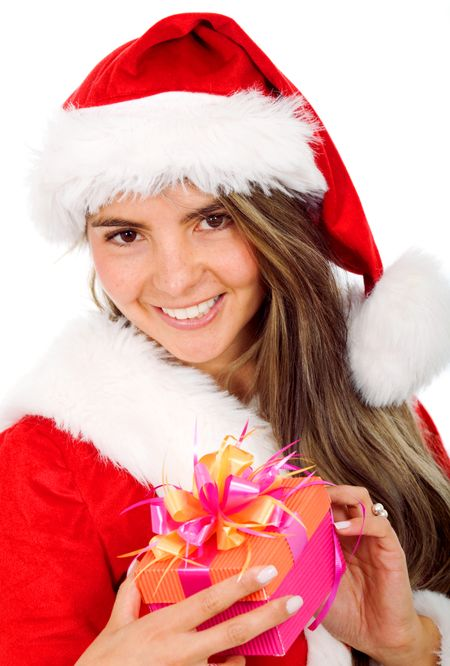 female santa smiling with a gift in her hands - isolated over a white background