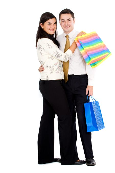 couple doing shopping with bags isolated over a white background