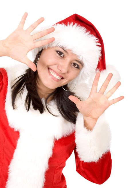 christmas female santa appearing in the frame looking happy with her hands next to her face - isolated over a white background