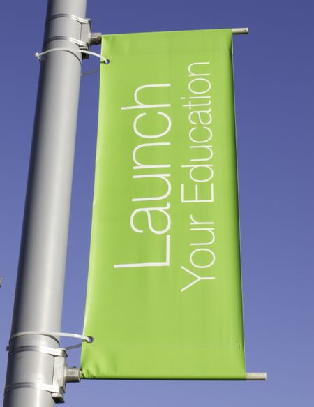 Motivational banner on campus of community college: Launch Your Education