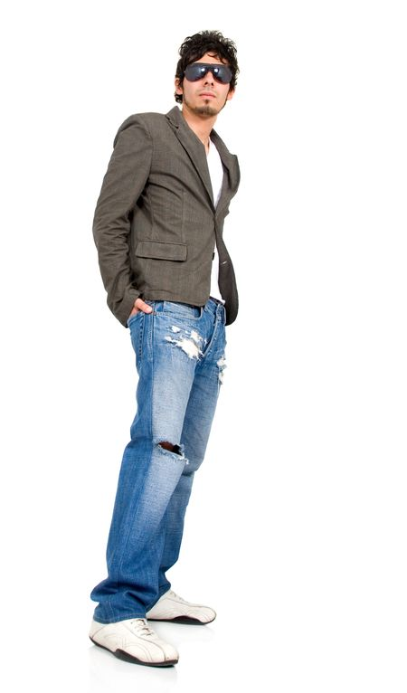 Casual friendly man in jeans and wearing sunglasses standing – isolated over a white background