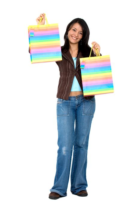 happy girl smiling holding shopping bags - isolated over a white background