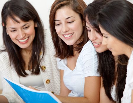 Group of girls studying at home with a notebook