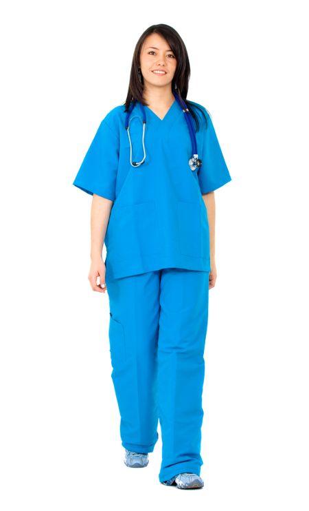 female nurse walking towards the camera isolated over a white background