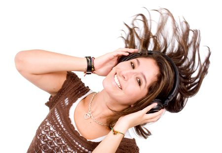 girl dancing with the music on her personal stereo isolated over a white background
