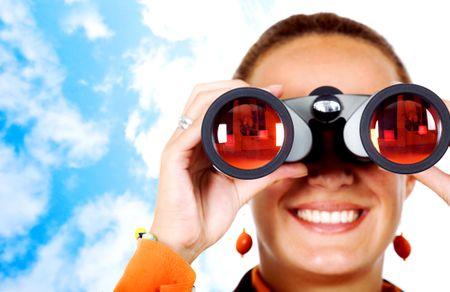 business search - woman looking through binoculars