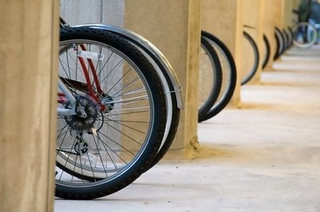 Wheels of bicycles parked by university building