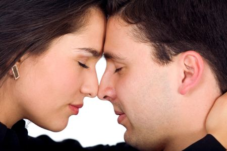 couple freaming together with eyes closed and facing each other - isolated over a white background