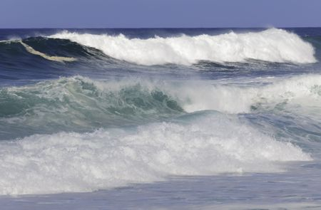 Surf rushing toward North Shore of Oahu