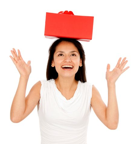 Woman with a red gift on her head - isolated over a white background