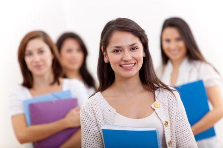 Group of female students holding notebooks - isolated