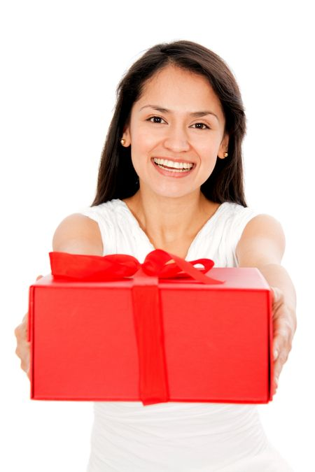 Woman holding a red gift - isolated over a white background