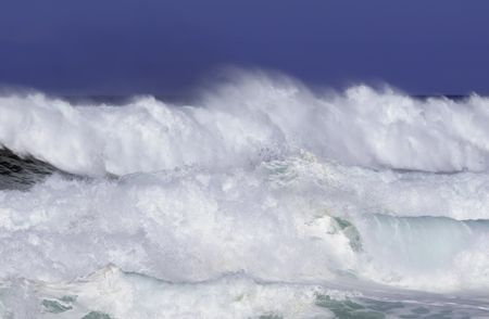 Breaking surf almost obliterates horizon of Pacific Ocean along North Shore of Oahu