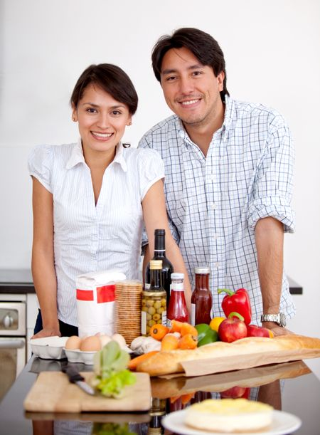 Couple in the kitchen cooking a romantic dinner