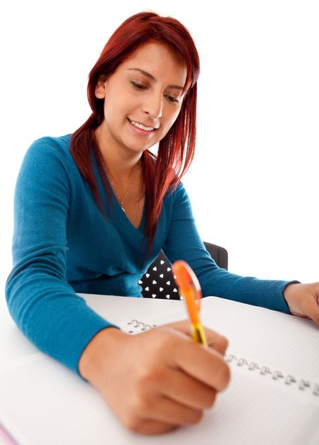 Female student writing on a notebook - isolated over white