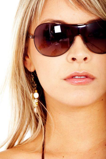 beautiful blond fashion woman wearing sunglasses over a white background
