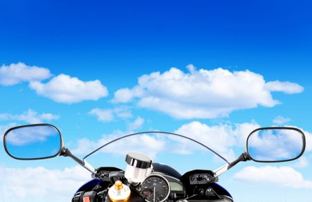 Motorcycle front with the view of a blue cloudy sky