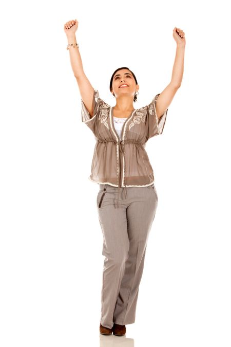 Happy business woman with arms up - isolated over white
