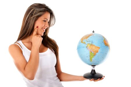 Woman looking at the globe - isolated over a white background