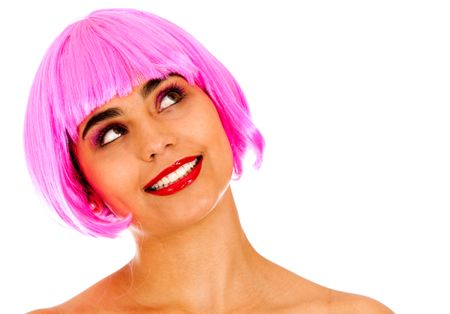 Beautiful pensive woman wearing a pink wig - isolated over a white background