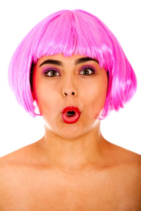 Eccentric woman portrait making faces with a pink wig - isolated