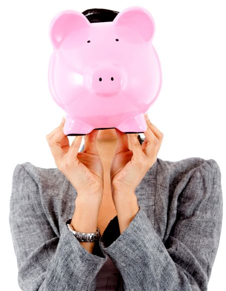 Woman with her savings in a piggy bank covering her face- isolated