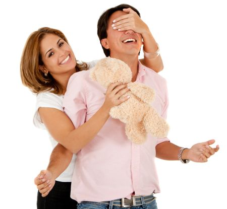 Romantic woman surprising her couple with a teddy bear ? isolated