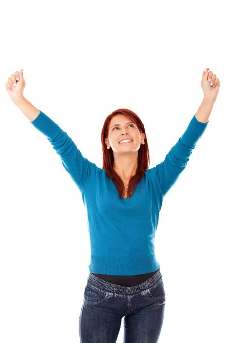 Happy woman with arms up - isolated over a white background