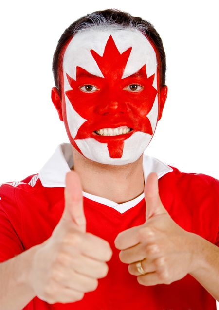 Happy Canadian man with the flag painted on his face and thumbs up- isolated