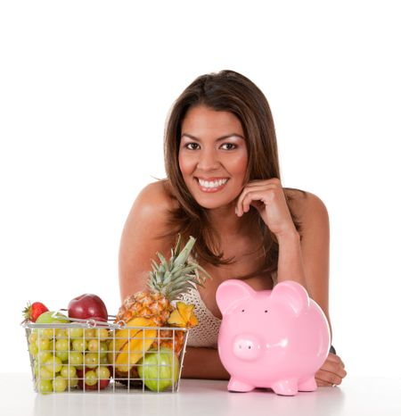 Healthy eating woman with a basket of fruits ? isolated over white